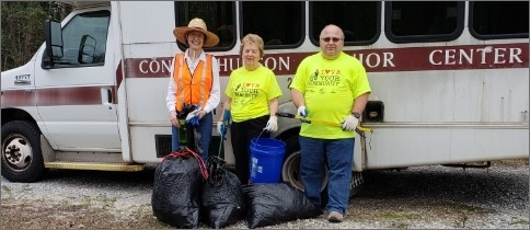 Three citizens involved in community cleanup